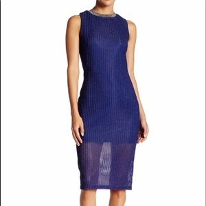 Navy dress fits woman sizes 8 to 12 comfortably